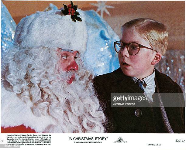 Peter Billingsley sits on Santa's lap in a scene from the film 'A Christmas Story' 1983