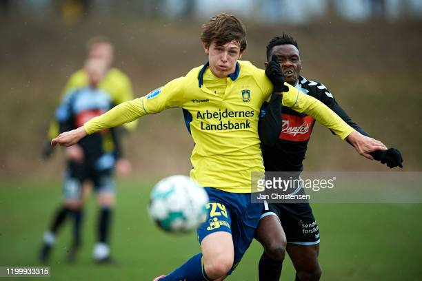 Peter Bjur of Brondby IF and Rilwan Hassan of SonderjyskE compete for the ball during the testmatch between Brondby IF and SonderjyskE at Brondby...