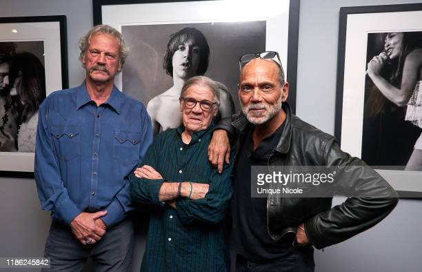 Peter Blachley Henry Diltz and Timothy White attend Conde Nast Collection Event at Morrison Hotel Gallery on November 07 2019 in West Hollywood...