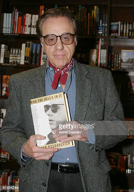 """Peter Bogdanovich poses with his book, """"Who's The Hell In It: Portraits & Conversations"""" at a book signing in Barnes and Noble October 8, 2004 in New..."""