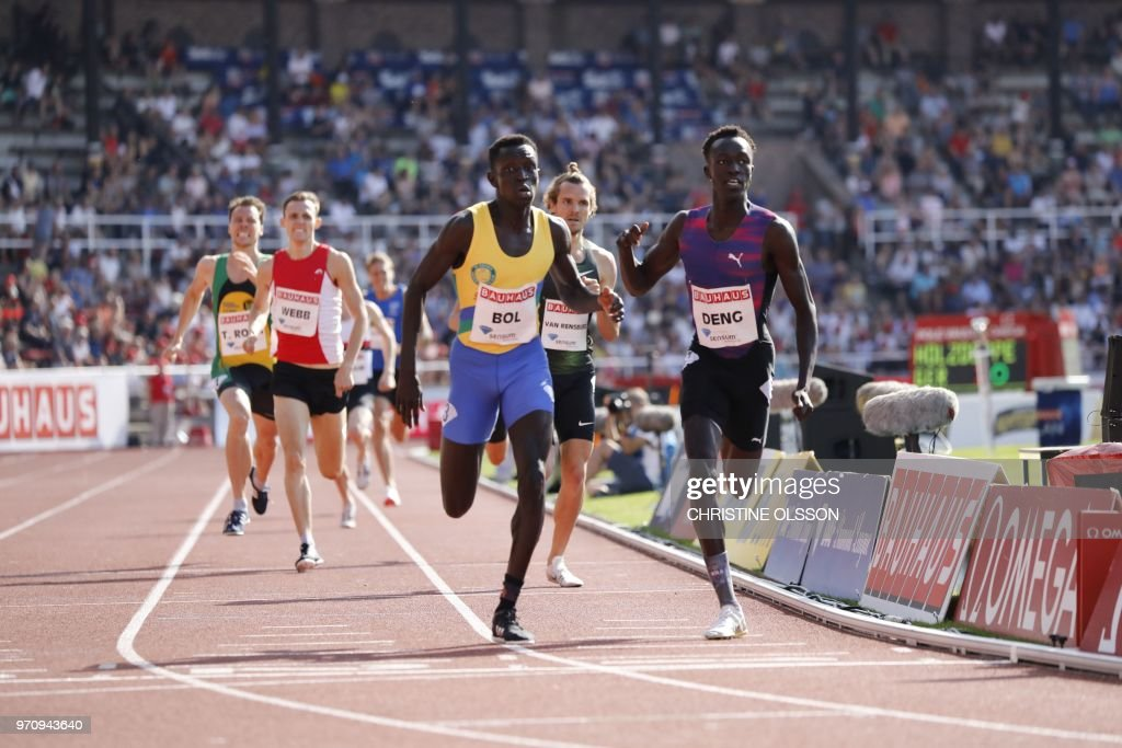 Peter Bol (C) of Australia competes to win before his compatriot Joseph Deng (R) and third placed Rynhardt van Rensburg (2nd R) of South Africa in the men's 800m event at the IAAF Diamond League 2018 meeting at Stockholm Olympic Stadium in Stockholm, Sweden, on June 10, 2018. (Photo by Christine Olsson / TT News Agency / AFP) / Sweden OUT