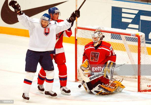 Peter Bondra of Slovakia raises his arms in celebration of his team's second goal in front of goaltender Tomas Vokoun and Tomas Kaberle of The Czech...