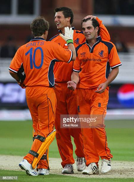 Peter Borren of Netherlands celebrates the wicket of Eoin Morgan of England with captain Jeroen Smits during the ICC World Twenty20 Group B match...