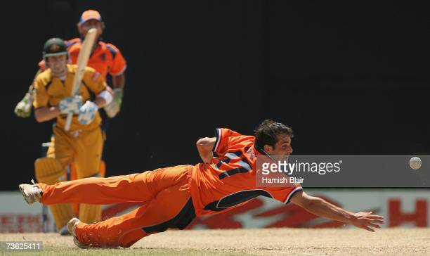 Peter Borren of Netherlands dives unsuccessfully after a drive from Michael Clarke of Australia with Jeroen Smits of Netherlands looking on during...