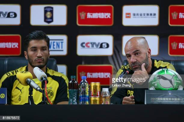 Peter Bosz coach of Borussia Dortmund with player Nuri Sahin attends the a press conference ahead of the 2017 International Champions Cup football...