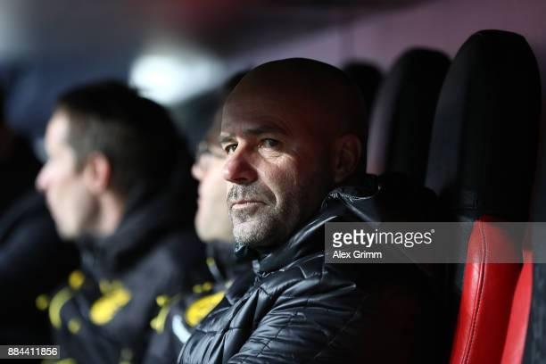 Peter Bosz coach of Dortmund sits on the bench before the Bundesliga match between Bayer 04 Leverkusen and Borussia Dortmund at BayArena on December...