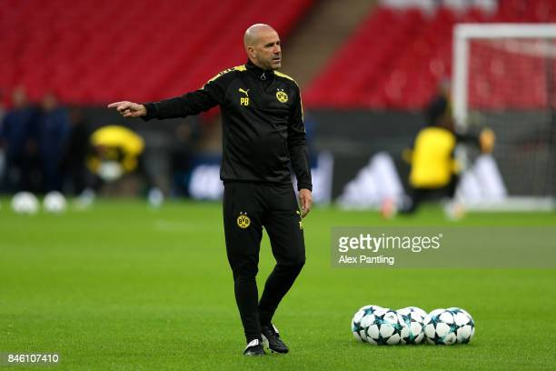 Peter Bosz head coach of Borussia Dortmund gives his team instructions during a Borussia Dortmund training session ahead of the UEFA Champions League...