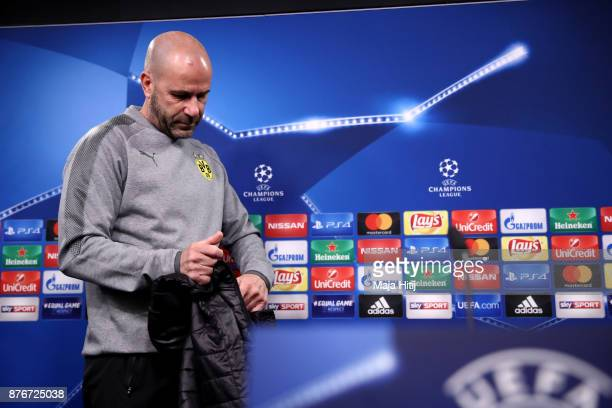 Peter Bosz head coach of Borussia Dortmund speaks during a Borussia Dortmund Press Conference ahead of the champions League Group H match between...