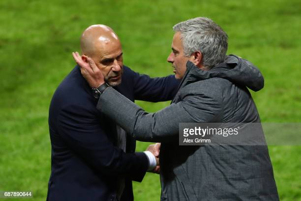 Peter Bosz Manager of Ajax and Jose Mourinho Manager of Manchester United embrace after the UEFA Europa League Final between Ajax and Manchester...