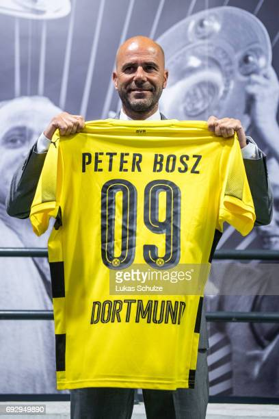 Peter Bosz the new head coach of Borussia Dortmund poses with a jersey of Dortmund after a press conference at Signal Iduna Park on June 6 2017 in...