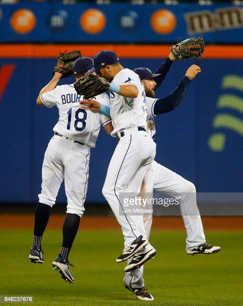 Peter Bourjos Kevin Kiermaier and Steven Souza Jr #20 of the Tampa Bay Rays celebrate after defeating the New York Yankees at Citi Field on September...