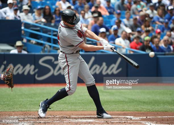 Peter Bourjos of the Atlanta Braves hits a solo home run in the third inning during MLB game action against the Toronto Blue Jays at Rogers Centre on...