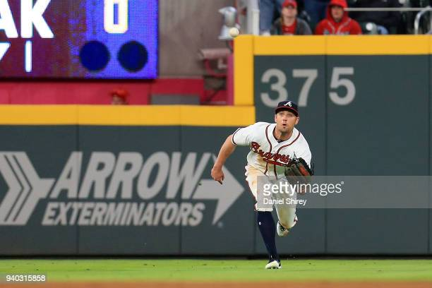 Peter Bourjos of the Atlanta Braves makes a diving catch during the ninth inning against the Philadelphia Phillies at SunTrust Park on March 30 2018...