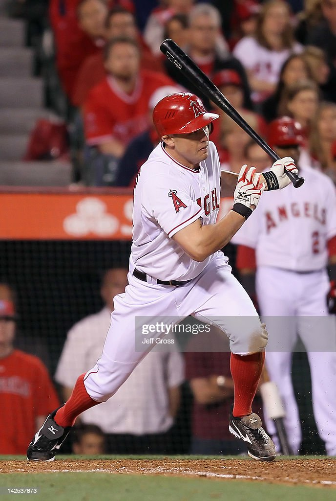 Peter Bourjos #25 of the Los Angeles Angels of Anaheim hits an RBI single against the Kansas City Royals in the eighth inning during the opening day game at Angel Stadium of Anaheim on April 6, 2012 in Anaheim, California. The Angels defeated the Royals 5-0.