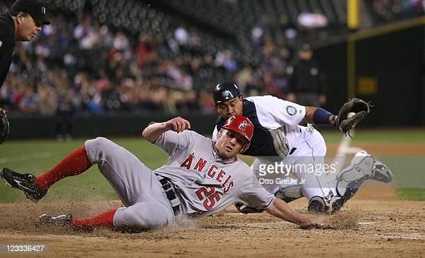 Peter Bourjos of the Los Angeles Angels of Anaheim is put out by catcher Miguel Olivo of the Seattle Mariners while trying to score on a fielders...