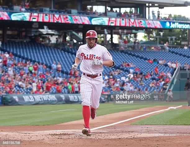 Peter Bourjos of the Philadelphia Phillies hits a solo home run in the bottom of the first inning against the Atlanta Braves at Citizens Bank Park on...
