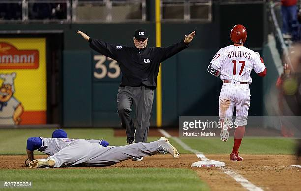 Peter Bourjos of the Philadelphia Phillies is called safe at first on a game winning walkoff infield single in the 11th inning during a game against...