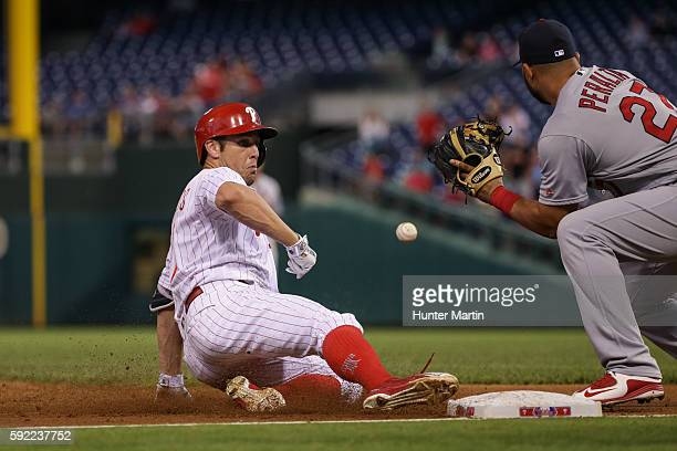 Peter Bourjos of the Philadelphia Phillies slides safely into third base with a triple in the second inning during a game against the St Louis...