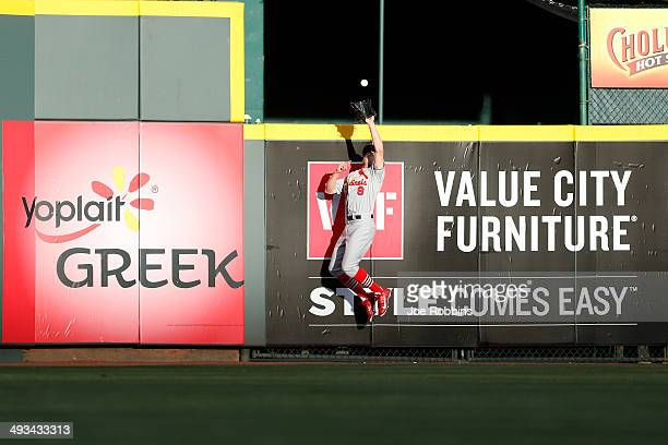 Peter Bourjos of the St Louis Cardinals catches a fly ball against the center field wall after a hit by Devin Mesoraco of the Cincinnati Reds in the...