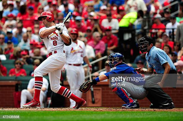 Peter Bourjos of the St Louis Cardinals hits an RBI triple against the Chicago Cubs during the second inning at Busch Stadium on May 7 2015 in St...