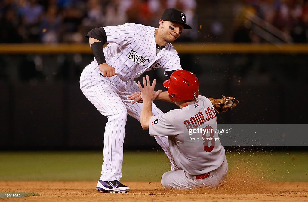 Peter Bourjos #8 of the St. Louis Cardinals is caught stealing second base as shortstop Troy Tulowitzki #2 of the Colorado Rockies makes the tag in the fifth inning at Coors Field on June 9, 2015 in Denver, Colorado.
