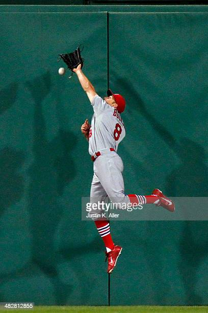 Peter Bourjos of the St Louis Cardinals misplays a ball in the third inning against the Pittsburgh Pirates during the game at PNC Park April 4 2014...