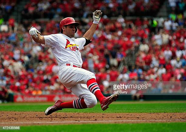 Peter Bourjos of the St Louis Cardinals slides into third for an RBI triple against the Chicago Cubs during the second inning at Busch Stadium on May...