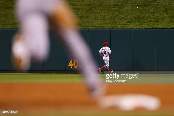 Peter Bourjos of the St Louis Cardinals watches a threerun home run hit by Joey Votto of the Cincinnati Reds leave the park in the sixth inning at...