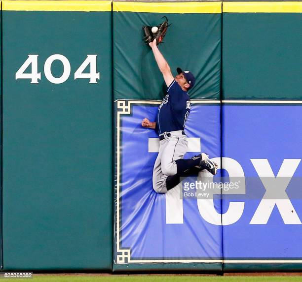 Peter Bourjos of the Tampa Bay Rays makes a leaping catch at the wall on a sharply hit fly ball by Alex Bregman of the Houston Astros in the third...
