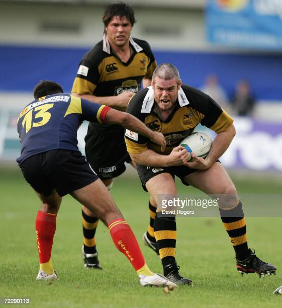 Peter Bracken of Wasps takes David Marty during the Heineken Cup match between Perpignan and London Wasps at Stade Aime Giral on October 28 2006 in...