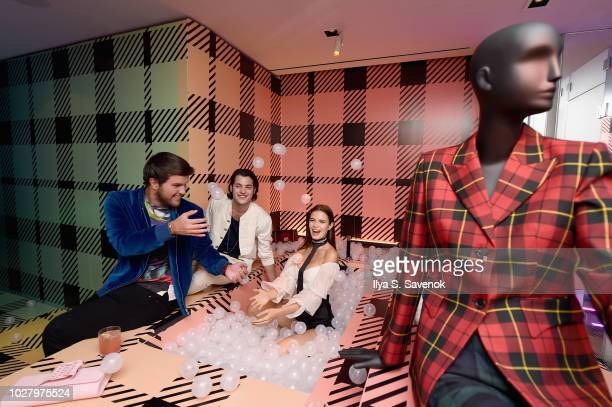 Peter Brant Jr Andrew Warren and Michaela Vybohova attend the launch of the Saks IT List Townhouse hosted by Glenda Bailey and Katie Holmes in...