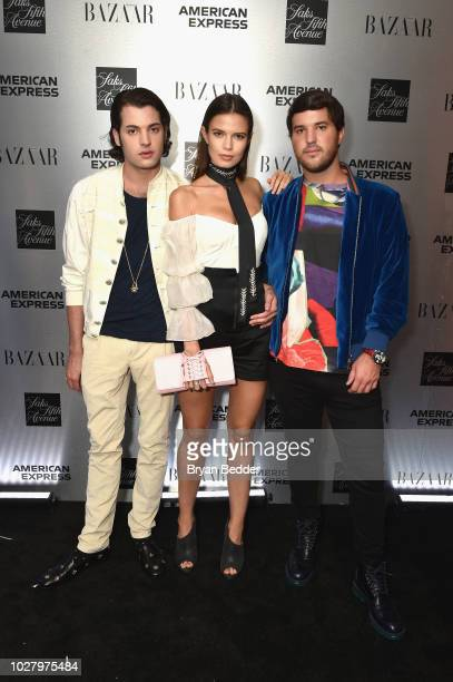 Peter Brant Jr Michaela Vybohova and Andrew Warren attend the launch of the Saks IT List Townhouse hosted by Glenda Bailey and Katie Holmes in...