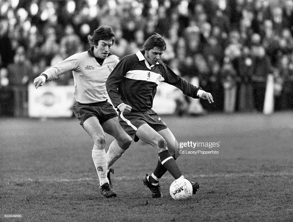 Peter Brine of Middlesbrough is challenged by M Holifield of Wycombe Wanderers (left) during the FA Cup 3rd round match between Wycombe and Middlesbrough at Loakes Park in High Wycombe, 4th January 1975. The non-league team held Middlesbrough to a 0-0 draw.