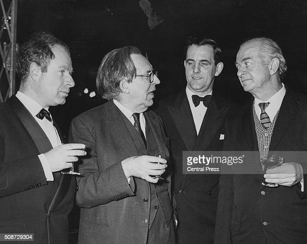 Peter Brooks Director of the play Professor of Physics J D Bernal Professor B J Mason and American chemist Linus Pauling chatting and drinking at the...