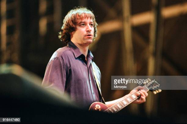 Peter Buck, R.E.M. In concert at the Galpharm Stadium, 25th July 1995.