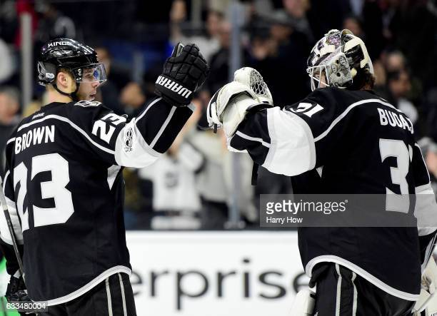 Peter Budaj of the Los Angeles Kings celebrates a 50 shutout win over the Colorado Avalanche with Dustin Brown at Staples Center on February 1 2017...