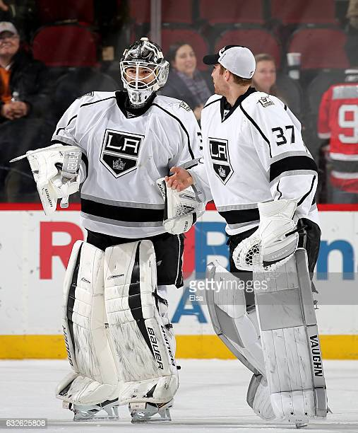 Peter Budaj of the Los Angeles Kings is congratulated by teammate Jeff Zatkoff after the 31 win over the New Jersey Devils on January 24 2017 at...