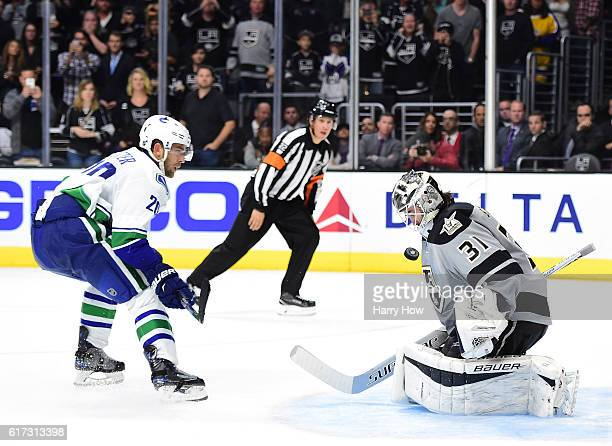 Peter Budaj of the Los Angeles Kings makes a save on Brandon Sutter of the Vancouver Canucks for a 4-3 overtime shootout win at Staples Center on...