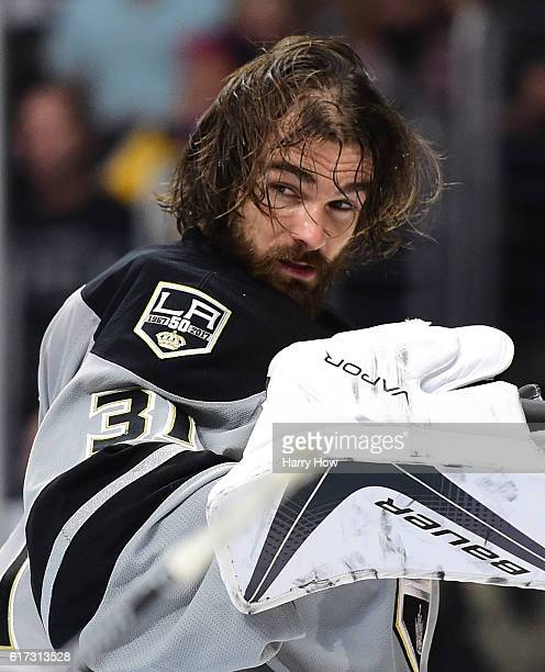 Peter Budaj of the Los Angeles Kings reacts after losing his helmet during the third period of a 43 overtime shotout win against the Vancouver...