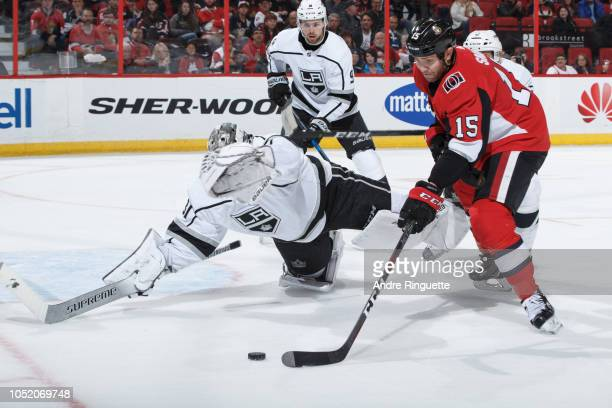 Peter Budaj of the Los Angeles Kings sprawls to make a save against Zack Smith of the Ottawa Senators as Adrian Kempe looks on at Canadian Tire...