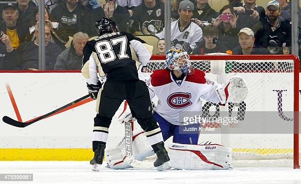 Peter Budaj of the Montreal Canadiens makes a save on Sidney Crosby of the Pittsburgh Penguins in the shootout during the game at Consol Energy...