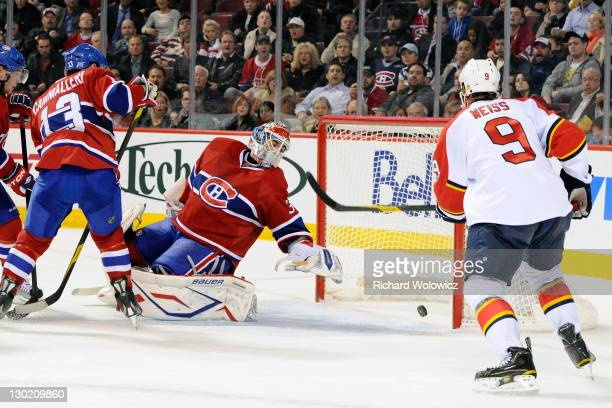 Peter Budaj of the Montreal Canadiens watches the puck go into the net on a goal by Tomas Fleischmann of the Florida Panthers during the NHL game at...