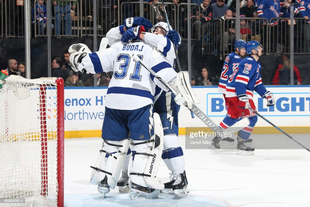 Peter Budaj #31 of the Tampa Bay Lightning celebrates with teammates after defeating the New York Rangers 3-2 at Madison Square Garden on March 13, 2017 in New York City.