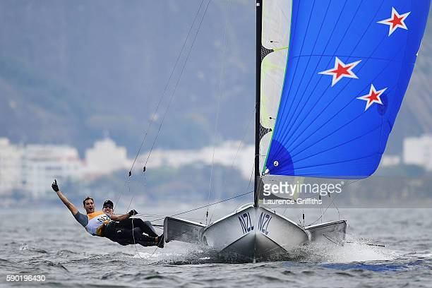 Peter Burling and Blair Tuke of New Zealand celebrate securing gold medal in the Men's 49er class on Day 11 of the Rio 2016 Olympic Games at the...