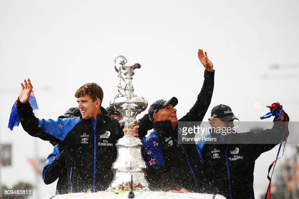 Peter Burling and Grant Dalton celebrate with the Americas Cup during the Team New Zealand Americas Cup Welcome Home Parade on July 6 2017 in...