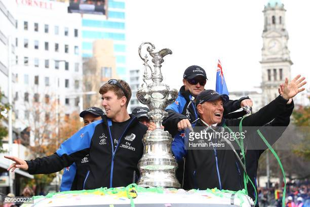 Peter Burling Grant Dalton and Glenn Ashby celebrate with the Americas Cup during the Team New Zealand Americas Cup Welcome Home Parade on July 6...