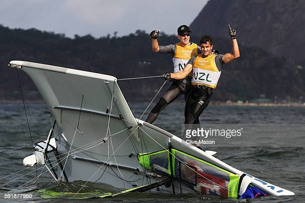Peter Burling of New Zealand and Blair Tuke of New Zealand celebrate after winning the gold medal in the Men's 49er class at the Marina da Gloria on...