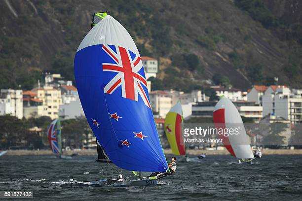 Peter Burling of New Zealand and Blair Tuke of New Zealand compete on the way to winning the gold medal in the Men's 49er class medal race at the...