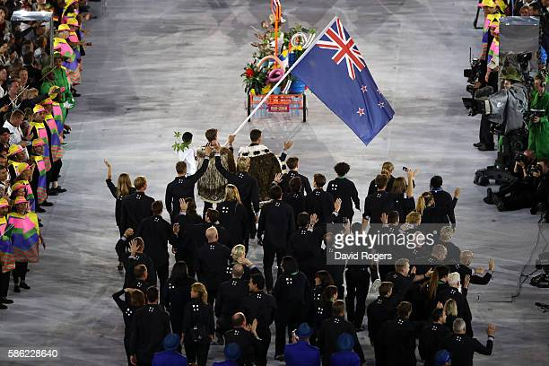 Peter Burling of New Zealand carries the flag during the Opening Ceremony of the Rio 2016 Olympic Games at Maracana Stadium on August 5 2016 in Rio...