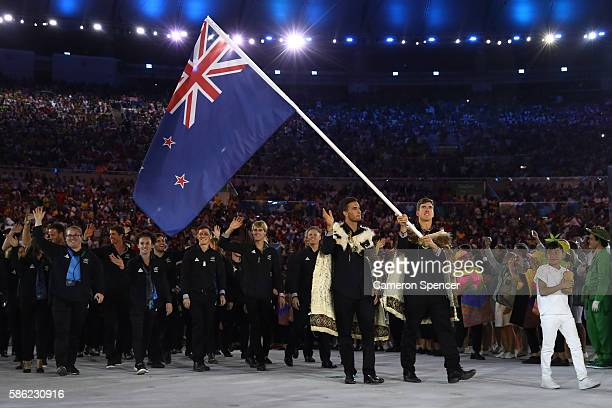 Peter Burling of New Zealand carries the flag during the Opening Ceremony of the Rio 2016 Olympic Games at Maracana Stadium on August 5, 2016 in Rio...